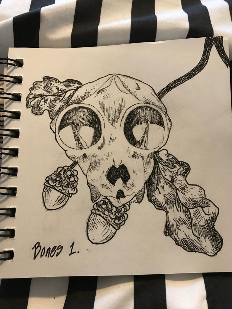 A picture of a squirrel skull with some acorns and oak leaves behind it