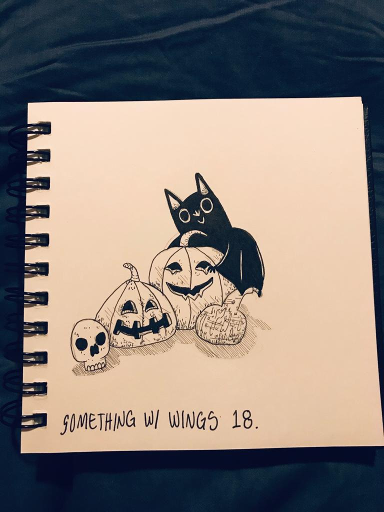 A picture of a bat with 3 jack-o-lanterns, which is nibbling on the largest jack-o-lantern